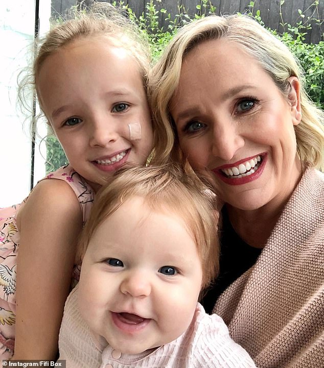In mourning: The sighting comes after Fifi (right) pulled out of her breakfast radio show on Tuesday following news that Jaimi (not pictured), the older half-sister of her daughter Trixie (left), had died at the age of 33. Pictured with her other daughter Daisy Belle (centre)