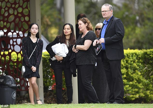 That morning, the Prime Minister had told Sydney radio 2GB broadcaster Ray Hadley a funeral would be held at 2pm in Mount Gravatt. The late Bernard Prendergast's 11-year-old grieving daughter Isobel Prendegast is pictured far left with her mother Myrna Prendergast (second right)