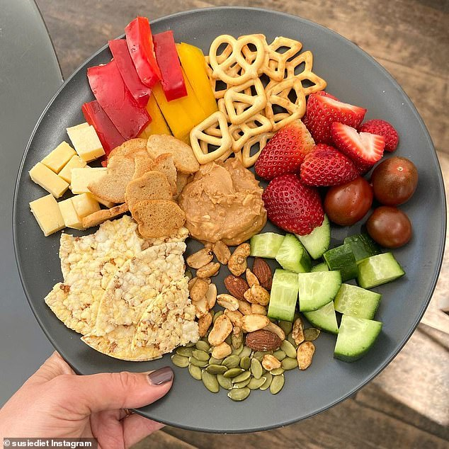 Susie suggested creating your own snacks (picture of wholegrain crackers, nuts, cut up cucumbers, cheeses, and strawberries)