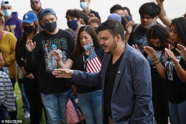 Speaker of Republican National Hispanic Assembly of California Anthony Cabasa leads a vigil prayer after ambush shooting