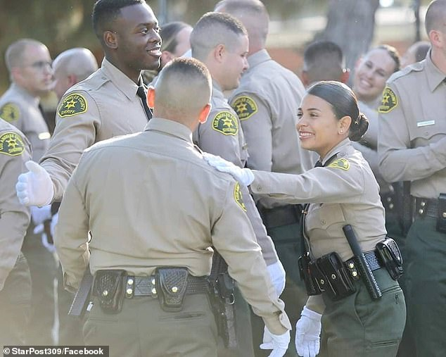 A video obtained by DailyMail.com of a graduation ceremony posted by the Department last year shows Claudia receiving her police academy certificate