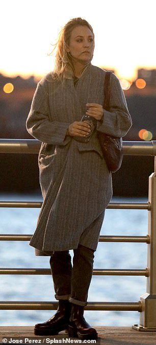 Ensemble: Braving the windy chill enveloping the bustling metropolis, the 34-year-old actress wrapped up in a smart grey coat