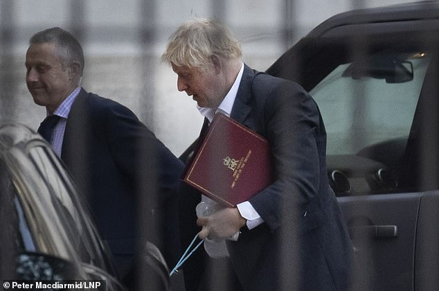 Although fiance Carrie Symonds was not in shot, it is believed she was not far behind carrying their four-month-old son