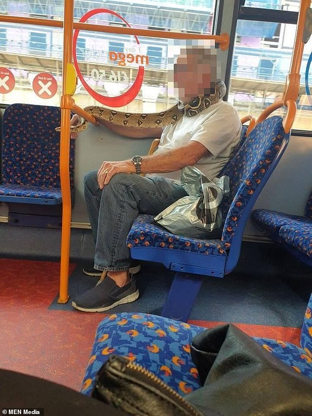 Bus passengers nearly had a hissy fit after spotting a man wearing a huge snake instead of a face mask while riding a bus in Salford yesterday
