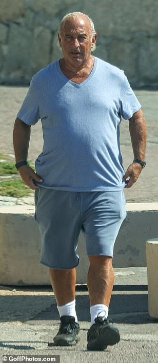Comfort: The tycoon ensured he was in total comfort in stretchy shorts and a loose tee