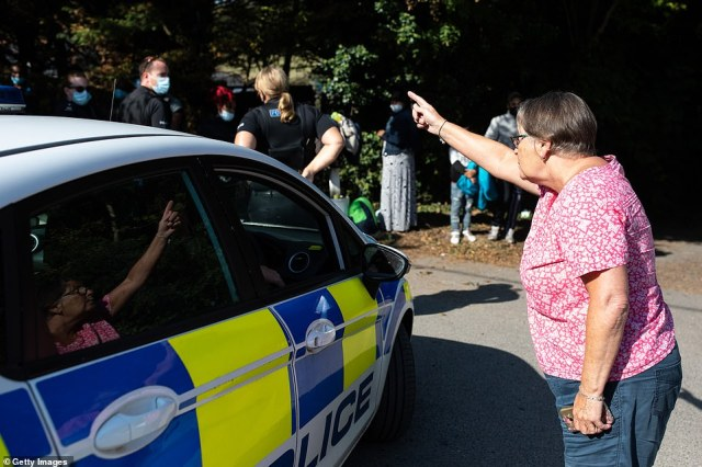Local Sue Cook told shouted at the group of migrants to 'p*** off home', before being told to mind her language by an officer