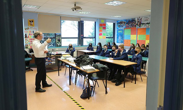 Schools are considered not fully open if they are unable to provide face-to-face teaching for all pupils on roll for the whole school day (pictured: pupils from Year 11 at Hazelwood Integrated College in Belfast are pictured during a lesson)