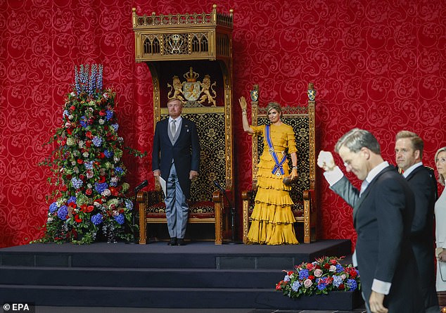 The smartly dressed couple stood proudly beside their thrones as Queen Maxima waved to the crowd, cutting a beautiful, lean hourglass figure