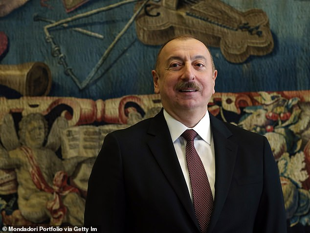 In Azerbaijan, Zhang wrote that she discovered that President Ilham Aliyev's (above) ruling political party 'utilized thousands of inauthentic assets... to harass the opposition en masse'