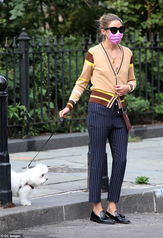 Chic: Palermo rocked a heavy beige cardigan with chocolate brown stripes and bright yellow accents on her shoulders