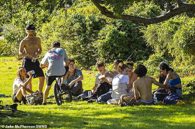 New coronavirus rules banning groups larger than six came under fire as a list of exemptions was published. Pictured, a group gather in St George Park, Bristol, on Monday
