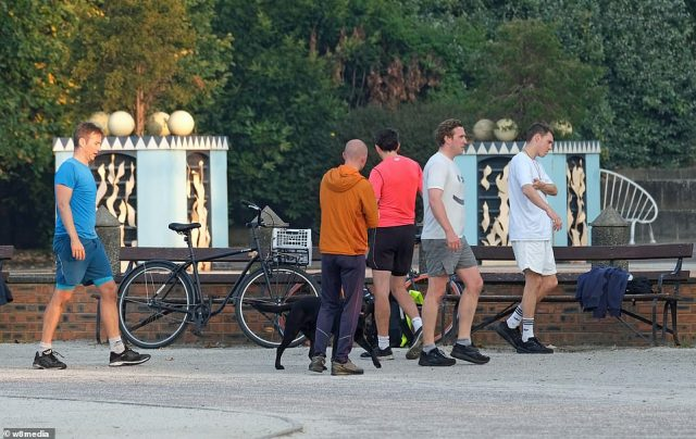 Dogwalkers and joggers out for an early morning stroll or run in Battersea Park in London this morning, ahead of a scorching day