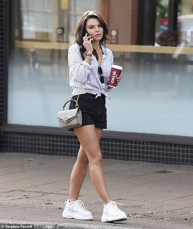 Wow:Faye Brookes put on a leggy display as she stepped out in black denim shorts after her hair appointment at Terence Paul in Hale, Cheshire, on Tuesday