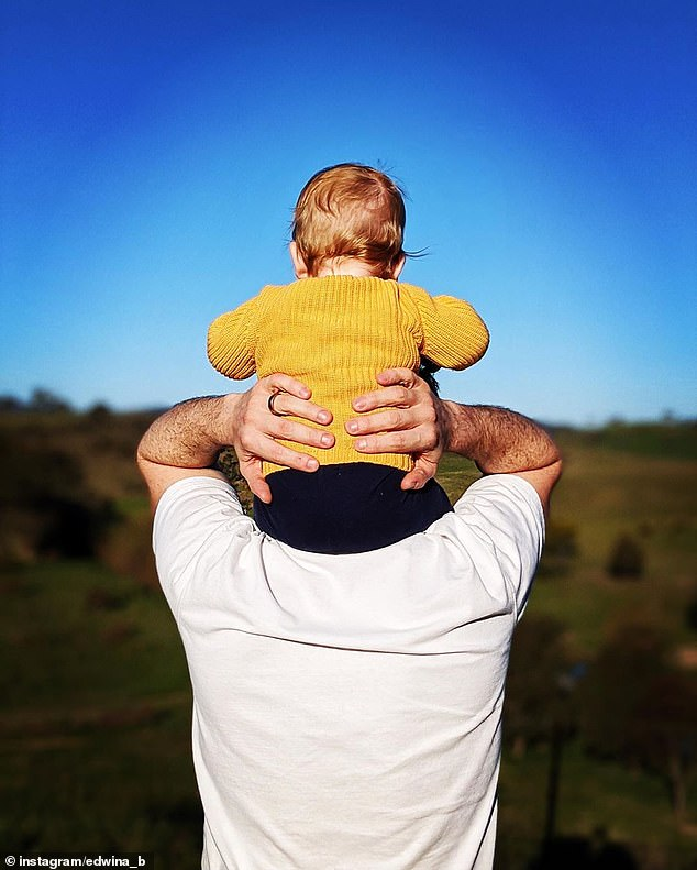 So sweet!A second photo shows little Molly sitting on her father's shoulders while they look away into the distance