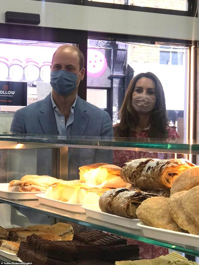 The couple wore masks as they arrived at the bakery in London before donning aprons and helping out in the shop by kneading some dough
