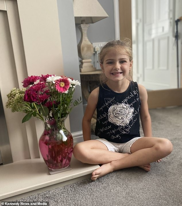 Sophie was extremely pleased with her boyfriend's gesture, placing the pink and white bouquet into a pink vase and posing proudly with them at home