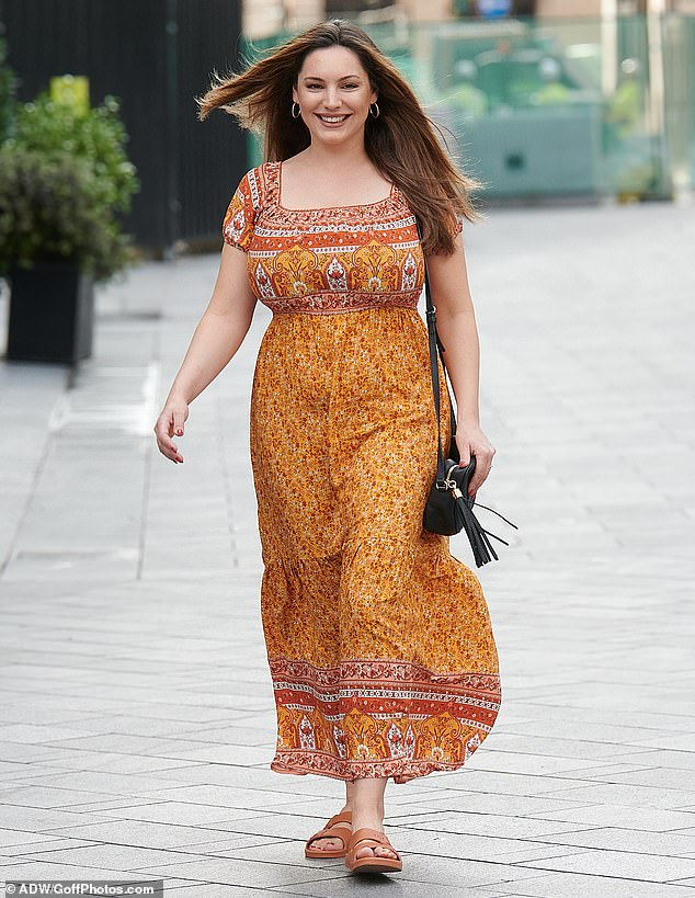Radiant:Kelly Brook looked radiant on Tuesday as she made a glamorous exit from her work at Heart Radio after revealing she has gained weight during lockdown