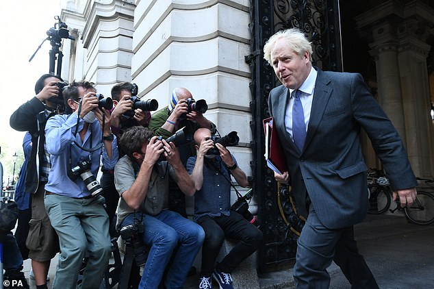Boris Johnson (pictured in Whitehall today) has insisted the 'Rule of Six' is needed to control the flare-up in coronavirus cases