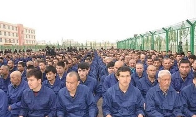 Disney's Mulan remake has faced boycott calls after it emerged that some of the blockbuster's scenes were filmed in China's Xinjiang. The above picture purports to show ethnic detainees sitting inside a 're-education' camp in the western Chinese province