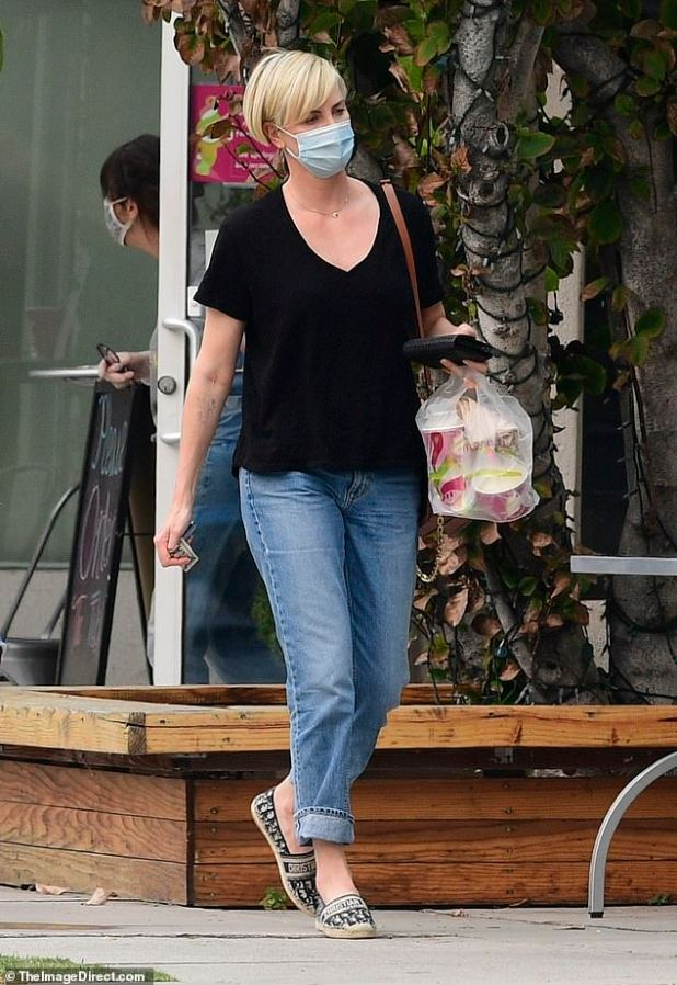 Masked!  The bombshell star covered a face as she picked up frozen yogurt in LA