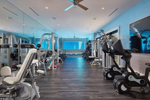 The property has a large gym complete with state-of-the-art equipment.