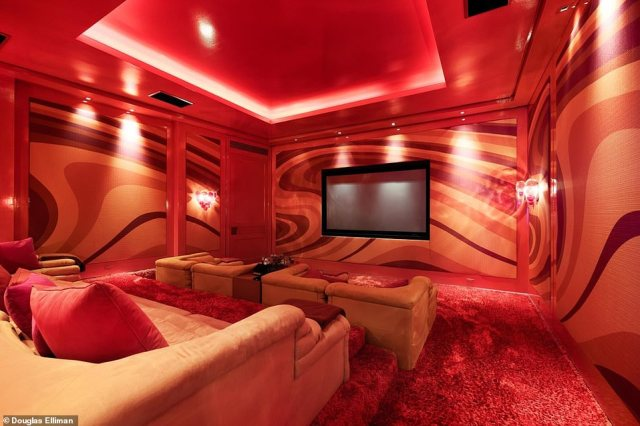 Florida estate: There's also a screening room with plush seating decorated in orange and red hues for movie nights