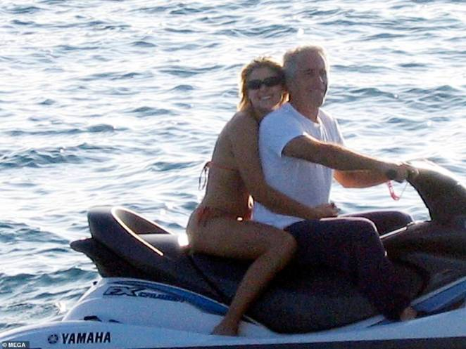 Jeffrey Epstein would watch nearly an hour of explicit episodes of Girls Gone Wild while working out, as the pedophile is seen surrounded by young women at his private Caribbean island in photos exclusively obtained by DailyMail.com. Pictured: Epstein with his personal assistant Sarah Kellen