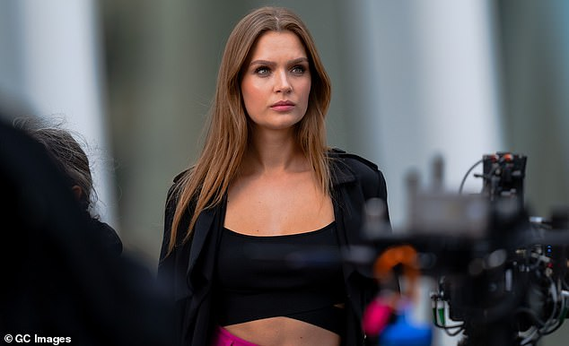 Serving face: The 27 year old model could be seen intently receiving direction while on set