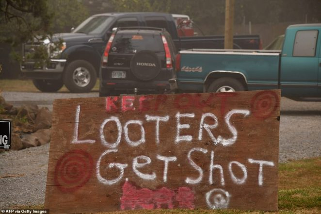 In Oregon, armed patrol groups are illegally stopping people in evacuation zones to assure looters don't come through