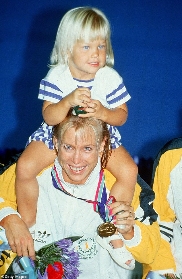 Struggle: While the family's statement onMonday afternoon didn't specify the nature of Jaimi's illness, it's understood she had long battled an eating disorder. Pictured:Lisa carriesJaimi on her shouldersafter winning gold at the1990 Commonwealth Games in Auckland