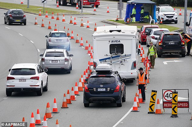 Queensland could move to reopen its border with NSW far sooner than expected. Pictured: Motorists are stopped at a checkpoint at Coolangatta on the Queensland-New South Wales border on August 7