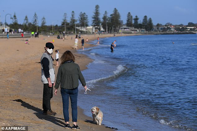 Regional Victoria will enter the Third Step ofPremier Daniel Andrews' lockdown reopening roadmap at 11.59pm on Wednesday night (Melbourne residents pictured on Monday)