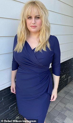 Blue beauty! Last month, Rebel showed off her slimmed down physique in a tight blue wrap dress on Instagram (pictured)