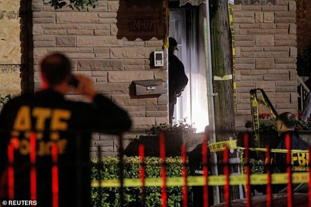 Law enforcement officers investigated outside the house on Tuesday night