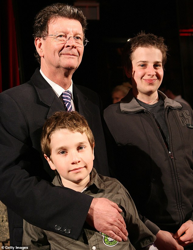 The band's most famous member Red Symons lost his son Samuel (right) after a 23-year long battle with cancer in 2018