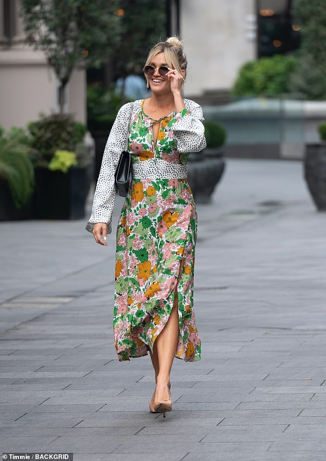 Strutting her stuff: Ashley Roberts turned heads as she arrived at Global Studios in London  to present her showbiz segment on the Heart Radio Breakfast Show on Wednesday