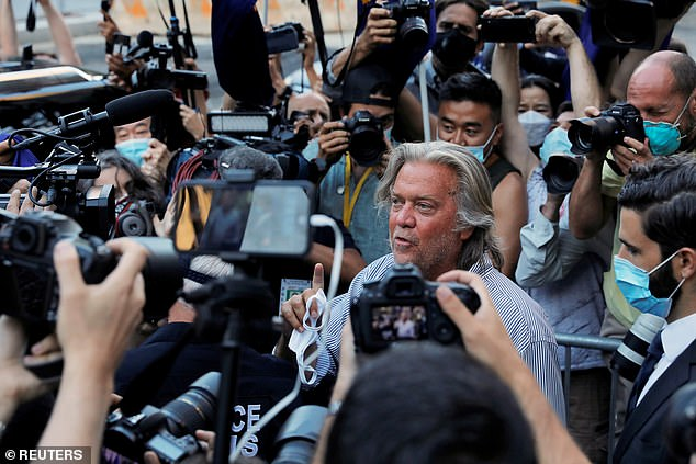 Bannon is surrounded by journalists as he leaves court in Manhattan last month