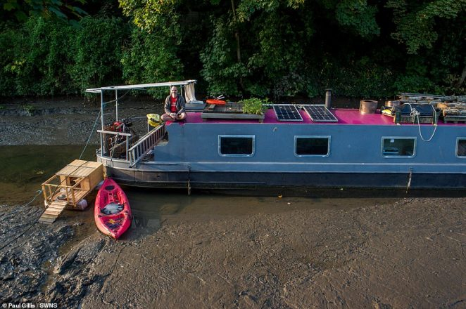 Passengers were left sat on top of their stranded boats, unable to walk ashore because of the thick mud on the canal bed