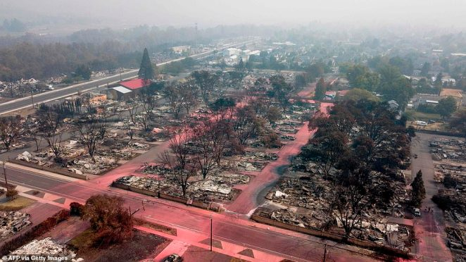 Devastating aerial footage shows the scorched Oregon town Talent, which was destroyed by the Almeda Fire last week. Drone footage shows homes reduced to rubble, streets covered in pink fire retardant and the neighborhood eerily empty