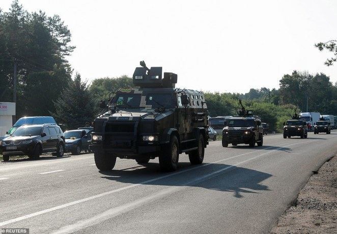 Armoured vehicles are seen near Novi Yarylovychi crossing point, where Jewish pilgrims are planning to enter Ukraine for a pilgrimage from the territory of Belarus, in Chernihiv Region, Ukraine on Wednesday