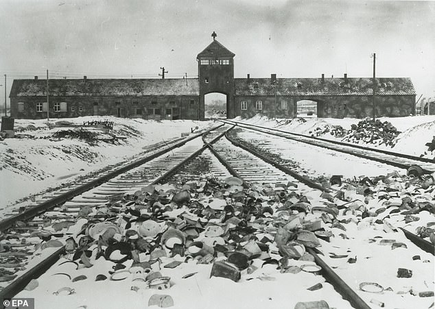 The unloading ramp and the main gate called the 'Gate of Death' at the former German Nazi concentration and extermination camp Auschwitz II-Birkenau are seen in 1945