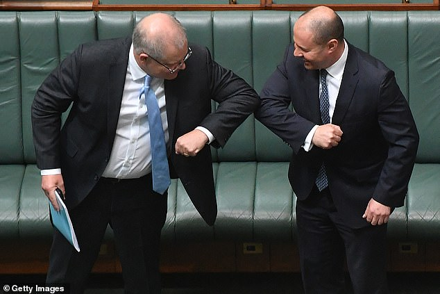 Sweeping new changes to Australia's citizenship test will see respondents face questions about key values like 'mateship' and having a 'fair go' (Pictured: Prime Minister Scott Morrison and Treasurer Josh Frydenberg bump elbows in a show of mateship in parliament)