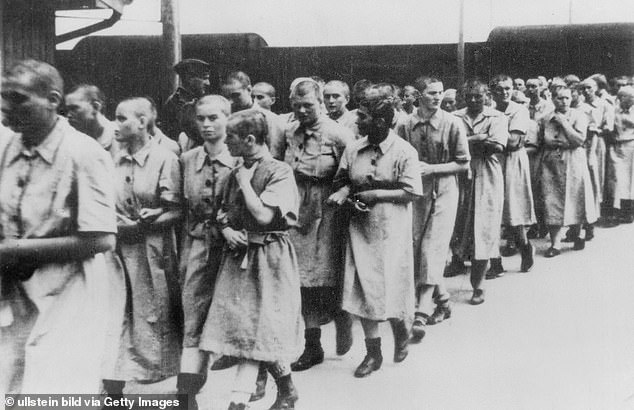 Women at the train station ramp of Auschwitz concentration camp - around 1944