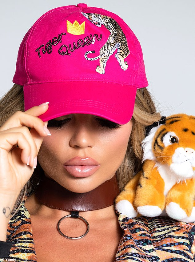 Accessories: The Tiger Queen costume comes with a 'Tiger Queen' hat and a stuffed tiger