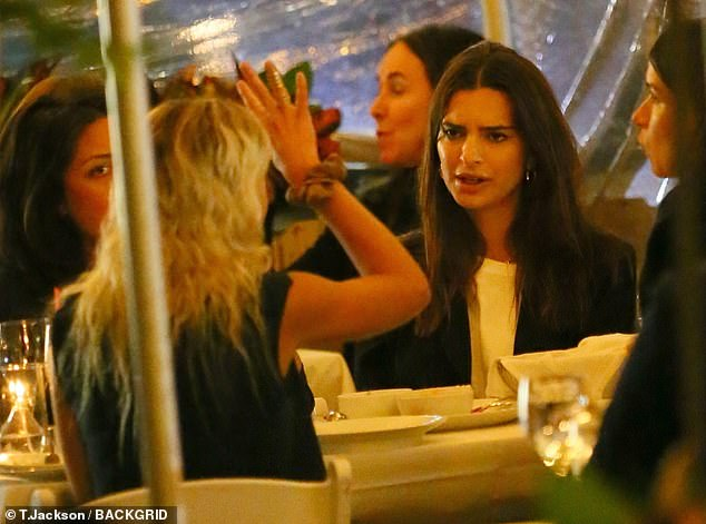 Chatting: Ratajkowski was photographed reacting during a conversation with a friend as she dined with several people atat Macquarie in New York City