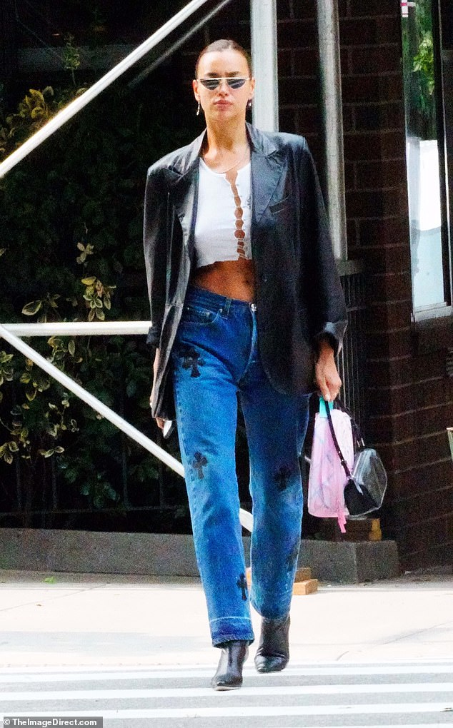 Strut: Russian bombshell Irina Shayk flaunted her taut tummy while going bra-less in a Chrome Hearts crop top during a solo stroll through Manhattan on Wednesday