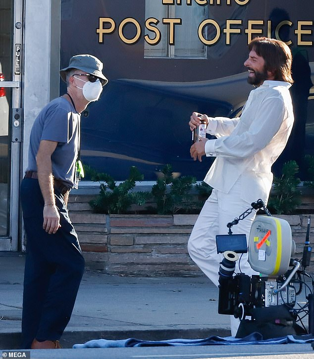 Untitled flick: Bradley is on break from filming his role as Barbra Streisand's hairdresser-turned-movie producer Jon Peters in Paul Thomas Anderson's (L) seventies San Fernando Valley-set movie (pictured August 29)