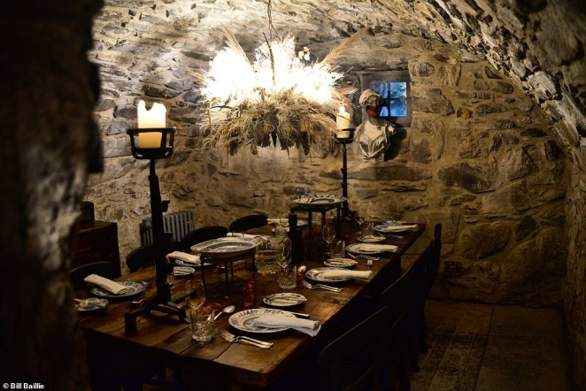 The castle's dining room, with its lordly table and dramatic stonework, has a marvellously medieval vibe