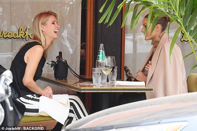 Good times: Later she met up with stunning blogger and socialite Olivia Palermo at Sant Ambroeus