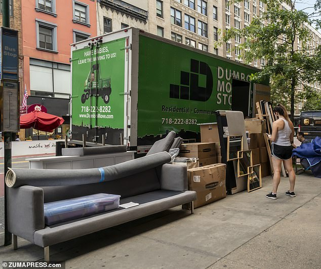 A moving van is seen loading up in Chelsea in New York on Tuesday July 14, 2020